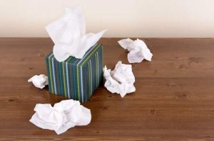 Tissues strewn across a wooden table